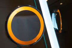 Round mirror with orange illumination Stock Images