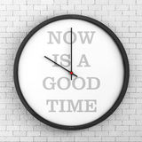 Round Modern Office Clock with Now Is a Good Time Sign. 3d Rende Stock Photos