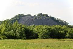 Round Mountain in Catoosa, Oklahoma. A granite mountain in Catoosa, Oklahoma, Tulsa county, overgrown with trees and grasses Royalty Free Stock Photography