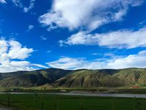 Round mountain and river,Tibet Royalty Free Stock Images