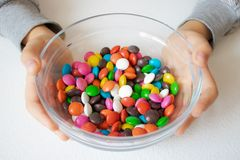Round, multi-colored candies. Candy close-up, in a glass container royalty free stock photography