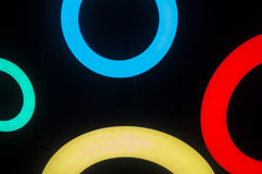Round neon fixtures against a dark background. Round neon fixtures against a dark background Royalty Free Stock Photography
