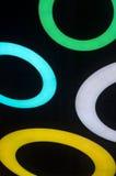 Round neon fixtures against a dark background. A Round neon fixtures against a dark background Royalty Free Stock Photo