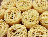 Round nests of pasta. Several round nests of pasta stock photography