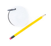 Round notepad and yellow pencil on white background Royalty Free Stock Image