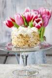 Round nut cake on cake stand Royalty Free Stock Photos