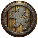 Round oak shield with rivets and metal Lev Royalty Free Stock Images