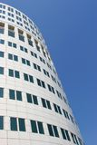 Round office building. Against a bright blue sky Stock Image