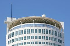 Round office building. Against a bright blue sky Stock Photography
