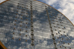 Round office building. Under clear blue sky blue glass window cloudy reflection Royalty Free Stock Image