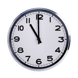 Round office clock shows eleven o'clock Royalty Free Stock Photography