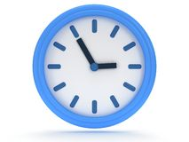 Round office clock shows five minutes to three Stock Photos