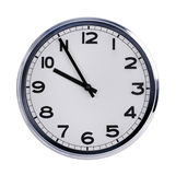 Round office clock shows ten o'clock Stock Image