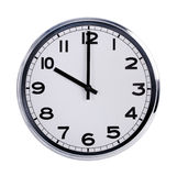Round office clock shows ten o'clock Royalty Free Stock Image