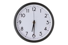 Round office wall clock on white,