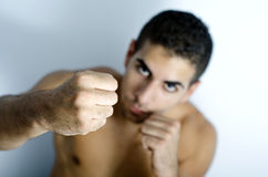 Round one. Image of a strong young man on a blue background Royalty Free Stock Image