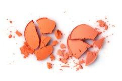 Round orange crashed eyeshadow for makeup as sample of cosmetics product Royalty Free Stock Photos