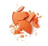 Round orange crashed eyeshadows for make up as sample of cosmetics product Royalty Free Stock Photo