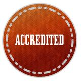 Round orange pattern badge with ACCREDITED message. Illustration graphic design concept image Royalty Free Stock Image