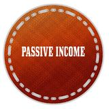 Round orange pattern badge with PASSIVE INCOME message. Illustration graphic design concept image Royalty Free Stock Photo