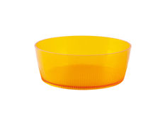 Round orange plastic dish Royalty Free Stock Images