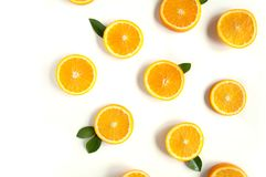 Round orange slices on a white background. Citrus tropical fruit background. Bright food. Dietary vitamin nutrition. Round orange slices on a white background royalty free stock photo