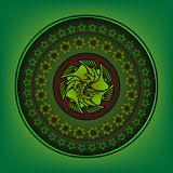 Round ornament with elaborate patterns on an green. Background Royalty Free Stock Image