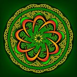 Round ornament with elaborate patterns on an green Stock Photo