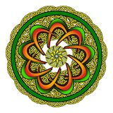 Round ornament with elaborate patterns on an green. Background Royalty Free Stock Photography