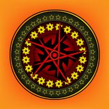 Round ornament with elaborate patterns on an orange. Background Stock Image