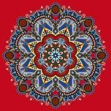 Round ornamental geometric doily pattern. Circle lace ornament, round ornamental geometric doily pattern on red background Stock Photo