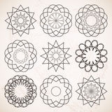 Round ornaments set over beige vintage background Royalty Free Stock Photos