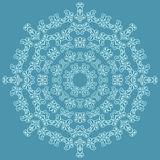 Round ornate pattern on blue background Royalty Free Stock Photography