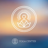 Round outline yoga logo. With abstract man silhouette in meditation pose on blurred background Stock Photos
