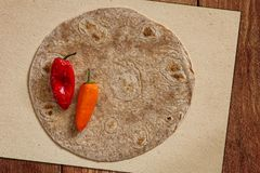 Round pancake and two bell peppers Stock Image