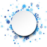 Round paper card over blue snowflakes. Royalty Free Stock Photos