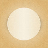 Round paper frame on curly beige pattern Stock Image