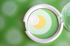 Round pastel green & yellow eyeshadow. Pastel green & yellow eyeshadow in round shape case Royalty Free Stock Photo