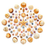 Round pattern of shells, starfish and glass beads on white background Stock Photography