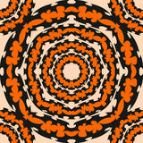 The round pattern of the wings of bats. Black on orange background Royalty Free Stock Photo