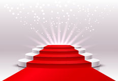 Round pedestal with a red carpet. Royalty Free Stock Photos