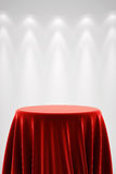 Round pedestal with red silk and spot light Stock Photo