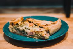 Round PIE with spinach and fish. Food closeupop Royalty Free Stock Photo