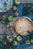 Round Pie Surround With Green Apple Fruits Stock Image