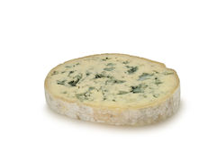 Round piece of blue cheese (Fourme d'Ambert) isolated on white background Royalty Free Stock Photo