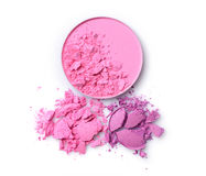 Round pink blusher and purple crashed eyeshadow for make up as sample of cosmetics product Stock Photography