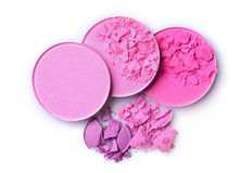 Round pink crashed blusher and eyeshadow for makeup as sample of cosmetic product Stock Photos