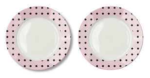 Round pink plate with black polka dots Royalty Free Stock Photos