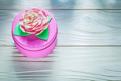 Round pink present box on wooden board celebrations concept Stock Images