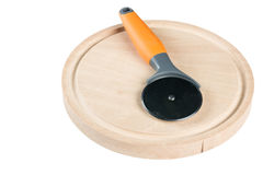 Round pizza knife on the round wooden cutting board Stock Photo
